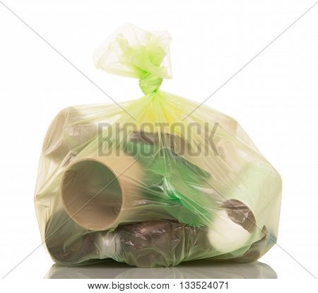 Full garbage bag with household waste isolated on white background.