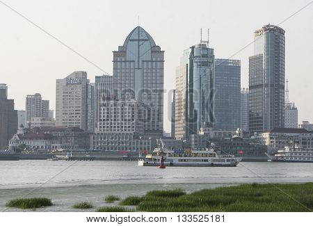 Shanghai, China - Apr 21, 2013: Office building and residential complex view from The Bund Shanghai over Huangpu river, Pudong area.