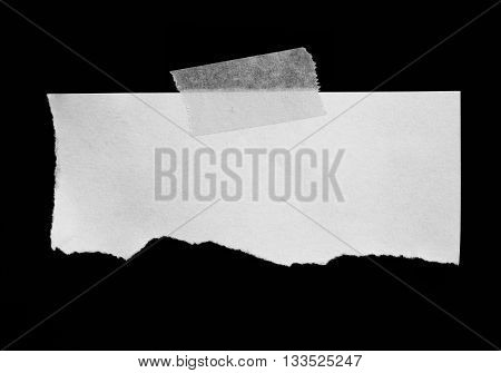 torn paper peeled off on black background
