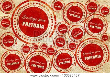 Greetings from pretoria, red stamp on a grunge paper texture