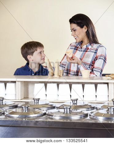 Mother And Son Selecting Between Cones And Cups