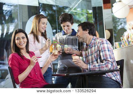 Happy Woman Having Ice Cream With Family