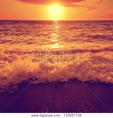 Dramatic sunset over sea and beach.
