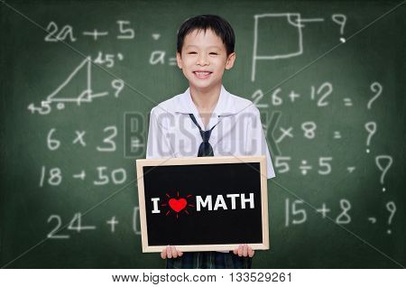 Asian schoolboy in uniform holding chalkboard with text
