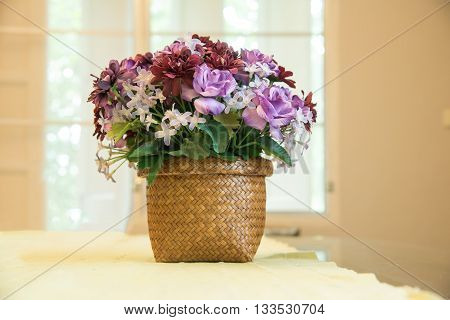 closed up the faked purple flower on vase