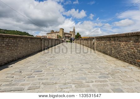 Bridge people houses and Church of Monastero Bormida in Piedmont Italy