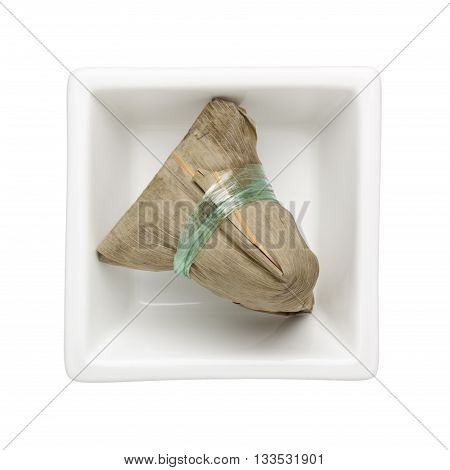 Chinese rice dumpling in a square bowl isolated on white background