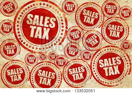 sales tax, red stamp on a grunge paper texture