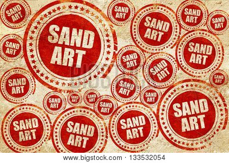 sand art, red stamp on a grunge paper texture