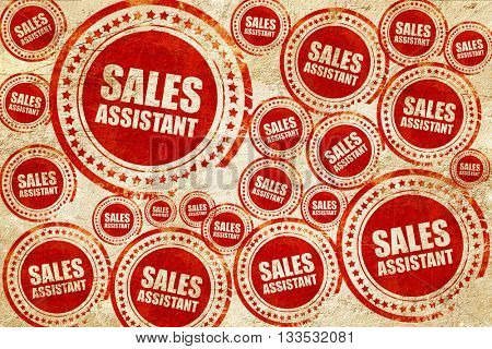 sales assistant, red stamp on a grunge paper texture