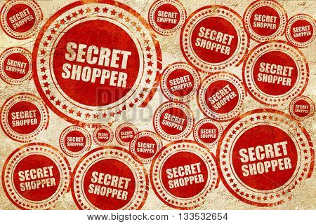 secret shopper, red stamp on a grunge paper texture