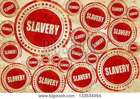 Slavery sign background, red stamp on a grunge paper texture