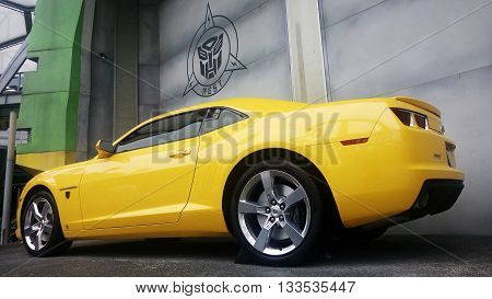 SINGAPORE JUN 04 2016: Real Size Yellow Chevrolet Camaro Car or Bumblebee Robot in Transformer Movie