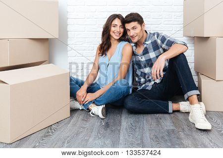 Happy young married couple moving in new house