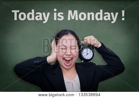 Today is Monday! written on blackboard with Asian business woman screaming