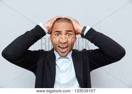 Close-up portrait of unhappy upset businessman guy isolated on gray background
