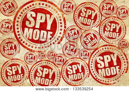 spy mode, red stamp on a grunge paper texture