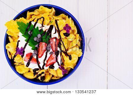Cornflakes with Strawberry and Chocolate. Healthy Breakfast Studio Photo