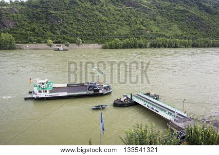 BOPPARD, GERMANY, 8 AUGUST 2014 - The Stadt Boppard car ferry crossing the river Rhine at Boppard Germany