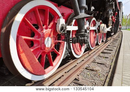 The old iron railway locomotive red wheels.