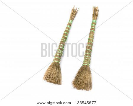 Two Paint brush isolated on a white background broom brush Tied with rope for painted For painted water building.( select focus front broom brush )