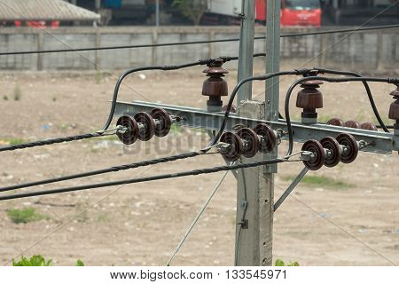 electricity post high voltage cable lines poles are connected together with wires and Blur blurred background (Top view)