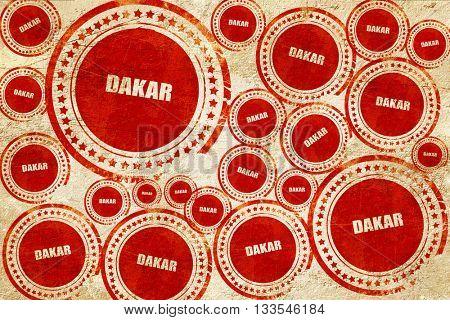 dakar, red stamp on a grunge paper texture