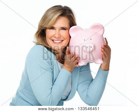 Senior woman with a piggy bank.