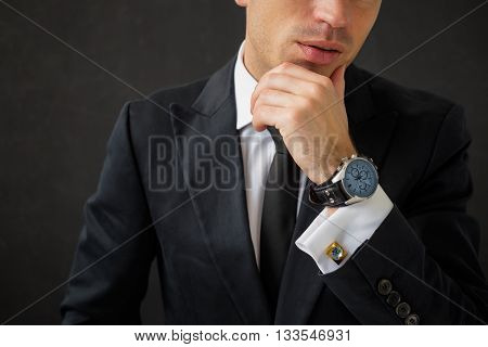 Business man with fancy wrist watch and cuff-links