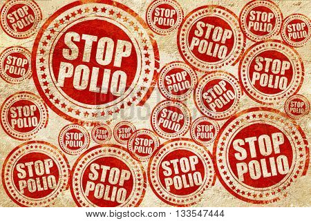 stop polio, red stamp on a grunge paper texture