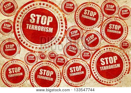 stop terrorism, red stamp on a grunge paper texture