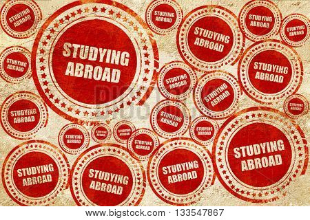 studying abroad, red stamp on a grunge paper texture