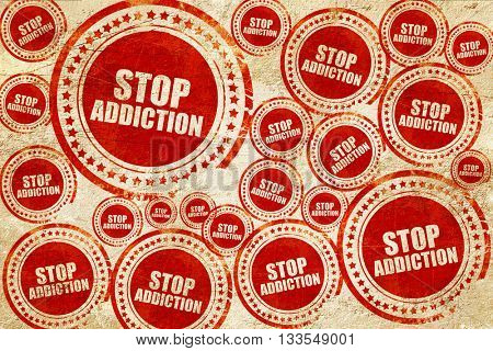 stop addiction, red stamp on a grunge paper texture