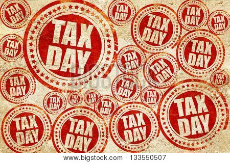 tax day, red stamp on a grunge paper texture