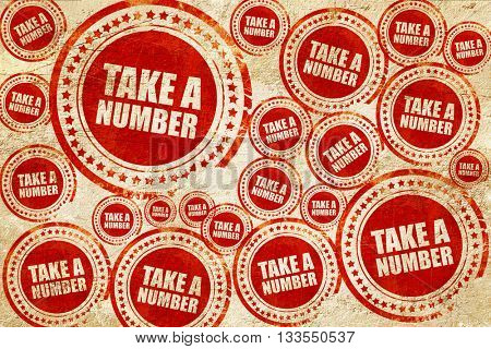 take a number, red stamp on a grunge paper texture
