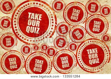 take our quiz, red stamp on a grunge paper texture