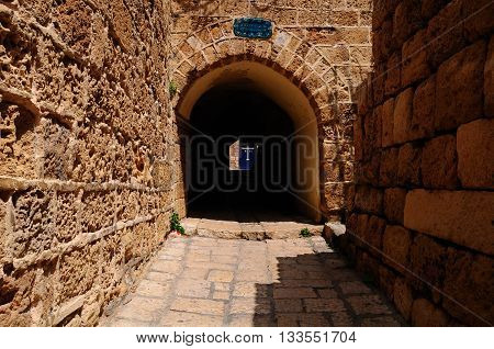 Arch passage in old Jaffa street. Israel.