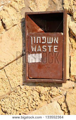 Refuse bin on some old wall in Jaffa. Israel.