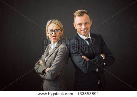 Corporate business man and woman standing with their hands crossed