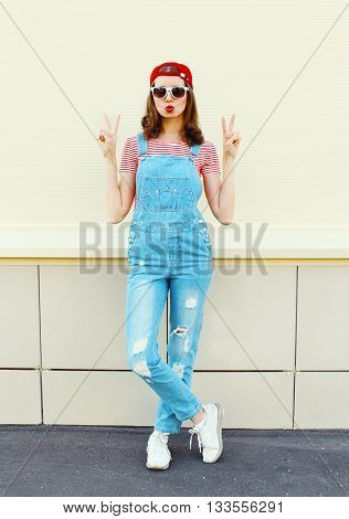 Fashion Pretty Woman In Denim Jumpsuit Over White Background