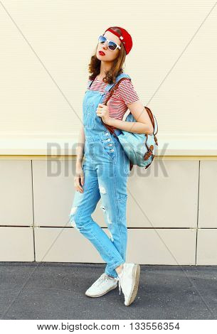 Fashion Pretty Woman Model In Denim Jumpsuit Over White Background