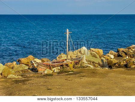 Scenic small shipwreck on beautiful rocky beach