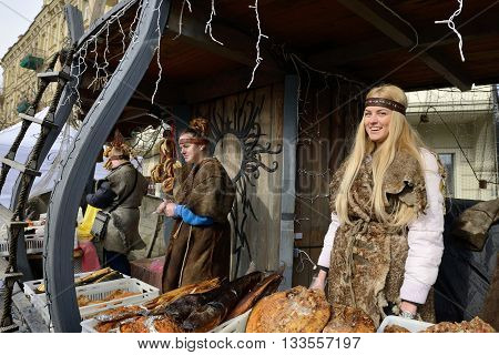 VILNIUS LITHUANIA - MARCH 6: Unidentified people trade smoked fish in annual traditional crafts fair - Kaziuko fair on Mar 6 2015 in Vilnius Lithuania