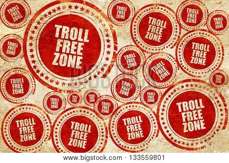 troll free zone, red stamp on a grunge paper texture