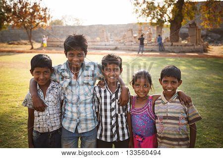 Hampi Karnataka India - Feb 27 2015: Unidentified Indian children smiling on excursion