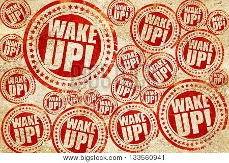 wake up, red stamp on a grunge paper texture