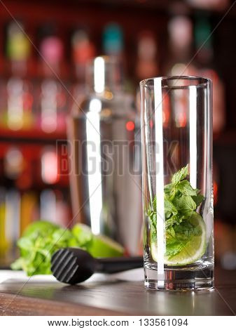 Mojito cocktail shot on a bar counter in a nightclub