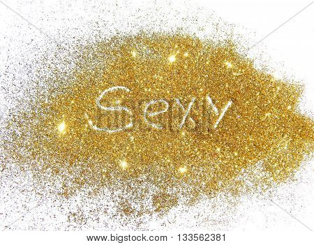 Word Sexy of golden glitter on white background