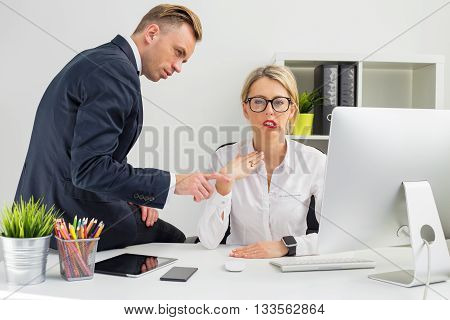 Employee being annoyed by her boss making comments