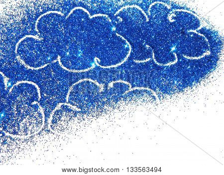 Abstract clouds of blue glitter on white background with place for your text